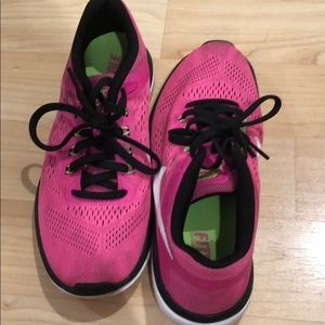 Pink nike flex running shoes